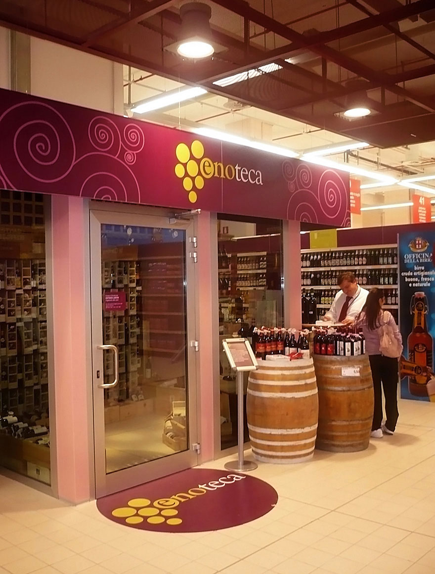 Retail am nagement de magasins cnc group - Amenagement bar a vin ...
